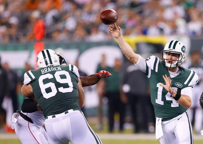 Aug 10, 2018; East Rutherford, NJ, USA; New York Jets quarterback Sam Darnold (14) throws a pass against Atlanta Falcons during first half at MetLife Stadium.