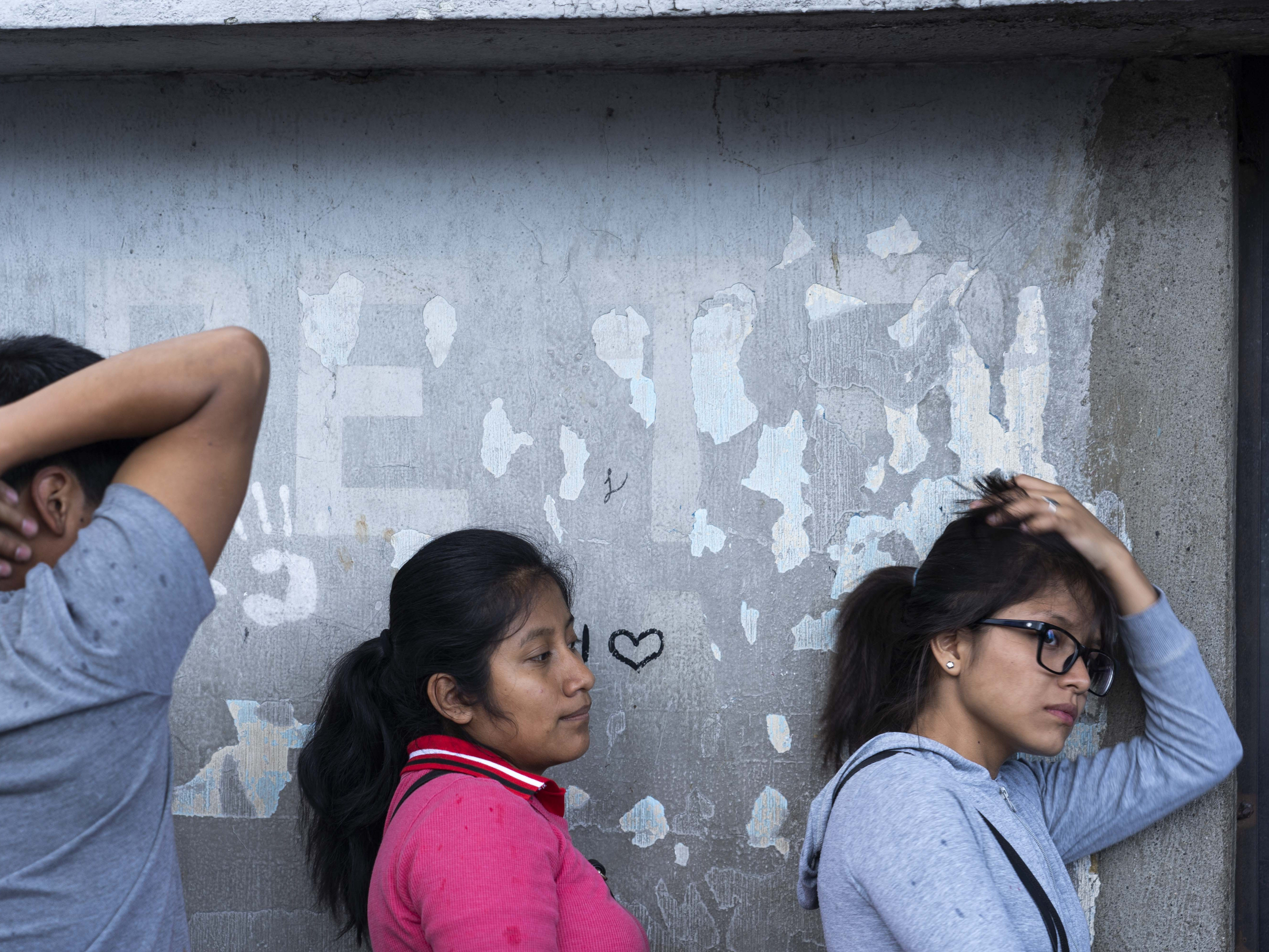 Relatives and friends wait outside a military base adjacent to the international airport in Guatemala City for deportees arriving from the United States.