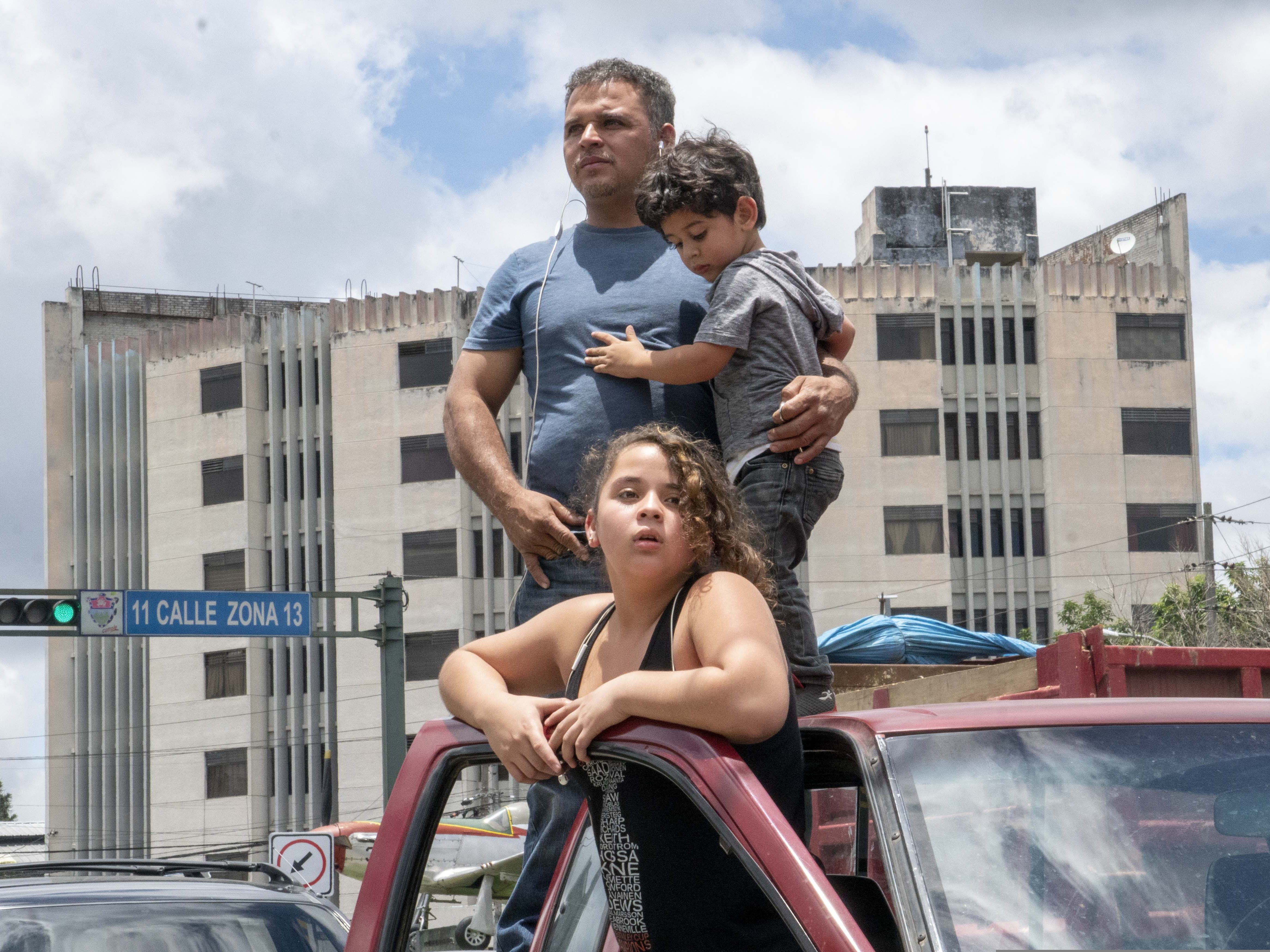 Jose Antonio Sandoval, 37, a car mechanic, waits for his wife Sandra Patricia Castaneda, 35, to arrive after she was deported from the U.S. to Guatemala. He drove to the Guatemalan capital with their 13-year-old daughter, Emily, and 2-year-old son, Abdiel. Their oldest son, Eduardo, is in Texas after passing a credible fear interview.