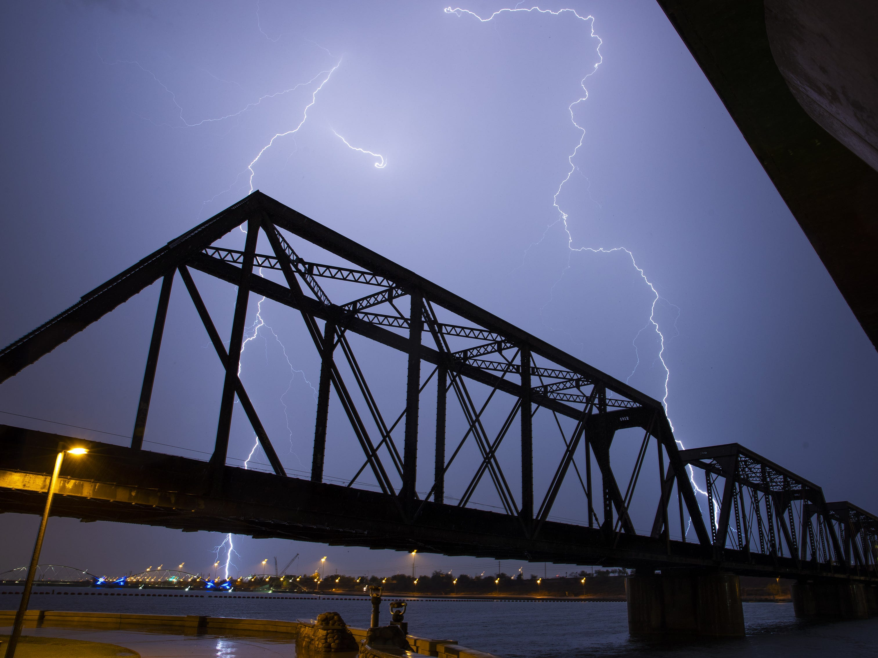 Lightning strikes over Tempe Town Lake during a monsoon storm August 10, 2018.