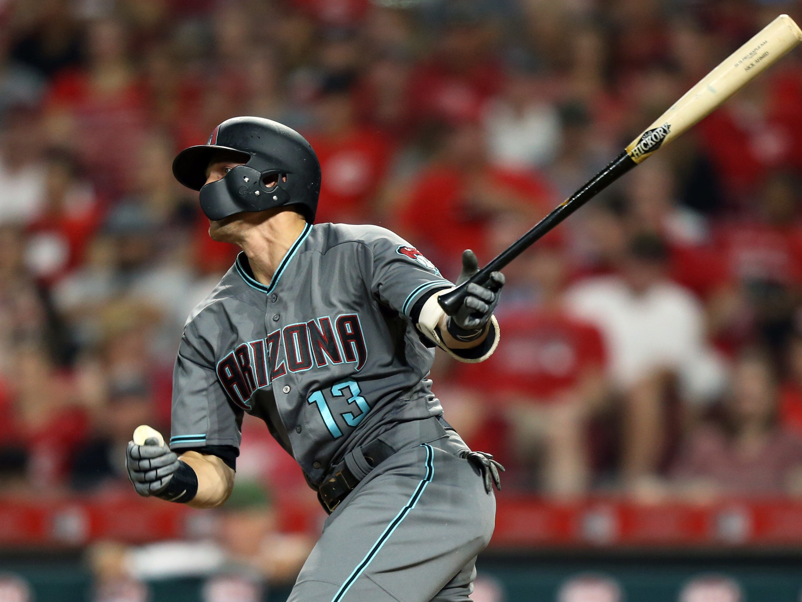 Aug 10, 2018; Cincinnati, OH, USA; Arizona Diamondbacks shortstop Nick Ahmed (13) singles against the Cincinnati Reds in the eighth inning at Great American Ball Park. Mandatory Credit: Aaron Doster-USA TODAY Sports