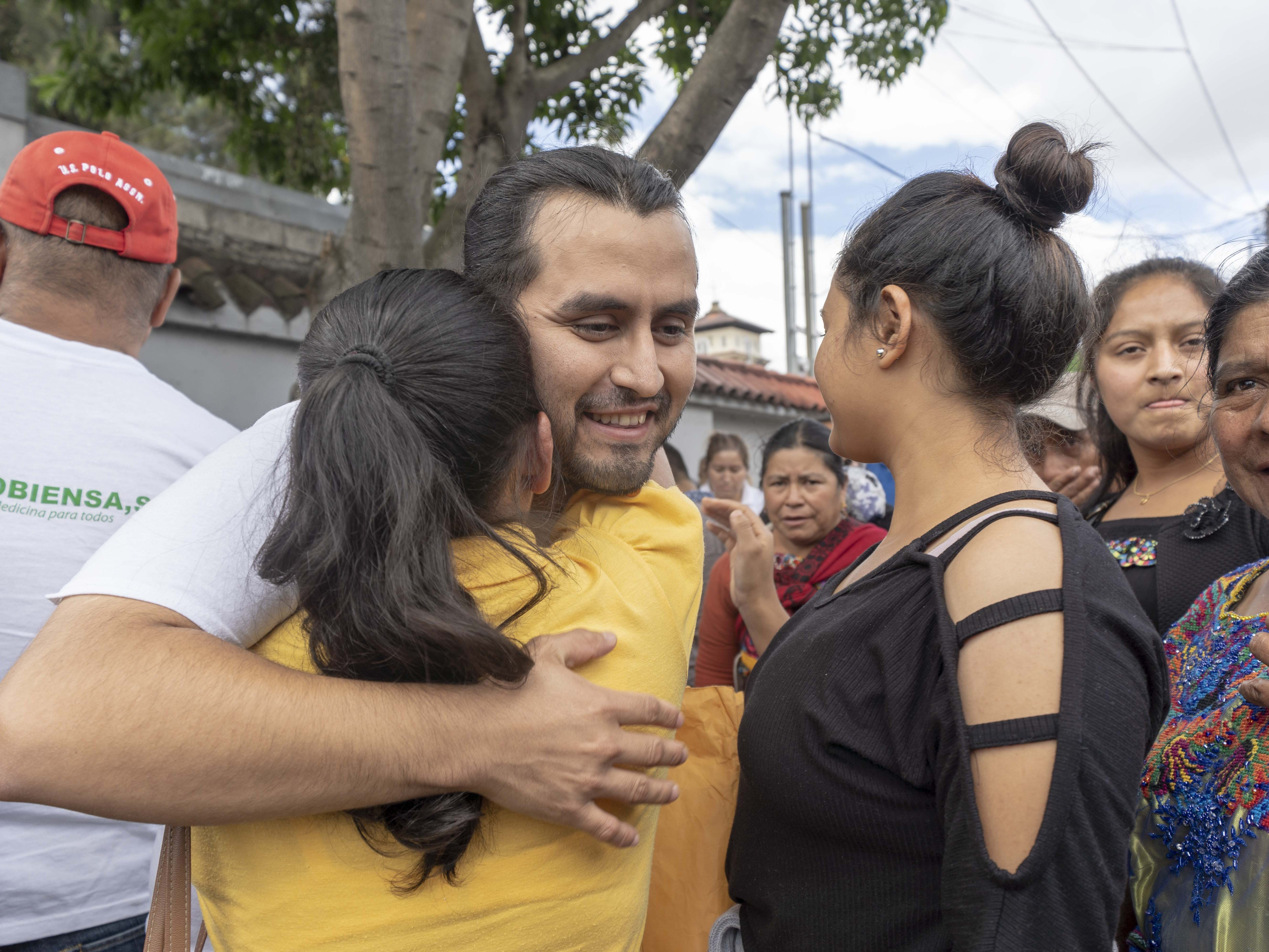 A young man hugs his family after being deported from the United States to Guatemala. He said he had been living in New York for 15 years.