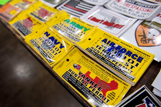 Stickers, one of the many novelties for sale, had 'hunting permits' for everything from terrorists to yankees at the Survival Expo at the York Expo Center.
