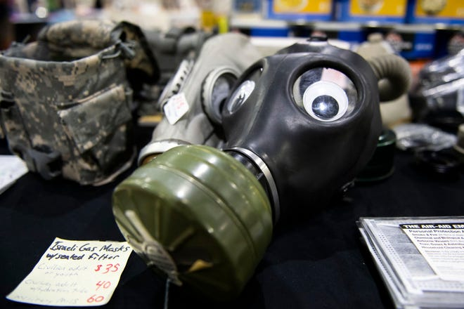 An 'Israeli gas mask' with googly eyes sits for sale at the Survival Expo at the York Expo Center, Saturday, August 11, 2018. The expo housed everything from essential oils to portable radiation detectors to gluten-free freeze dried meals.
