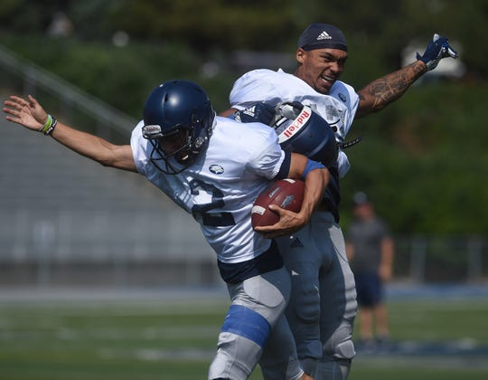 Brendan O'Leary-Orange, right, and Ian Zamudio celebrate a play during Nevada's scrimmage at Mackay Stadium.