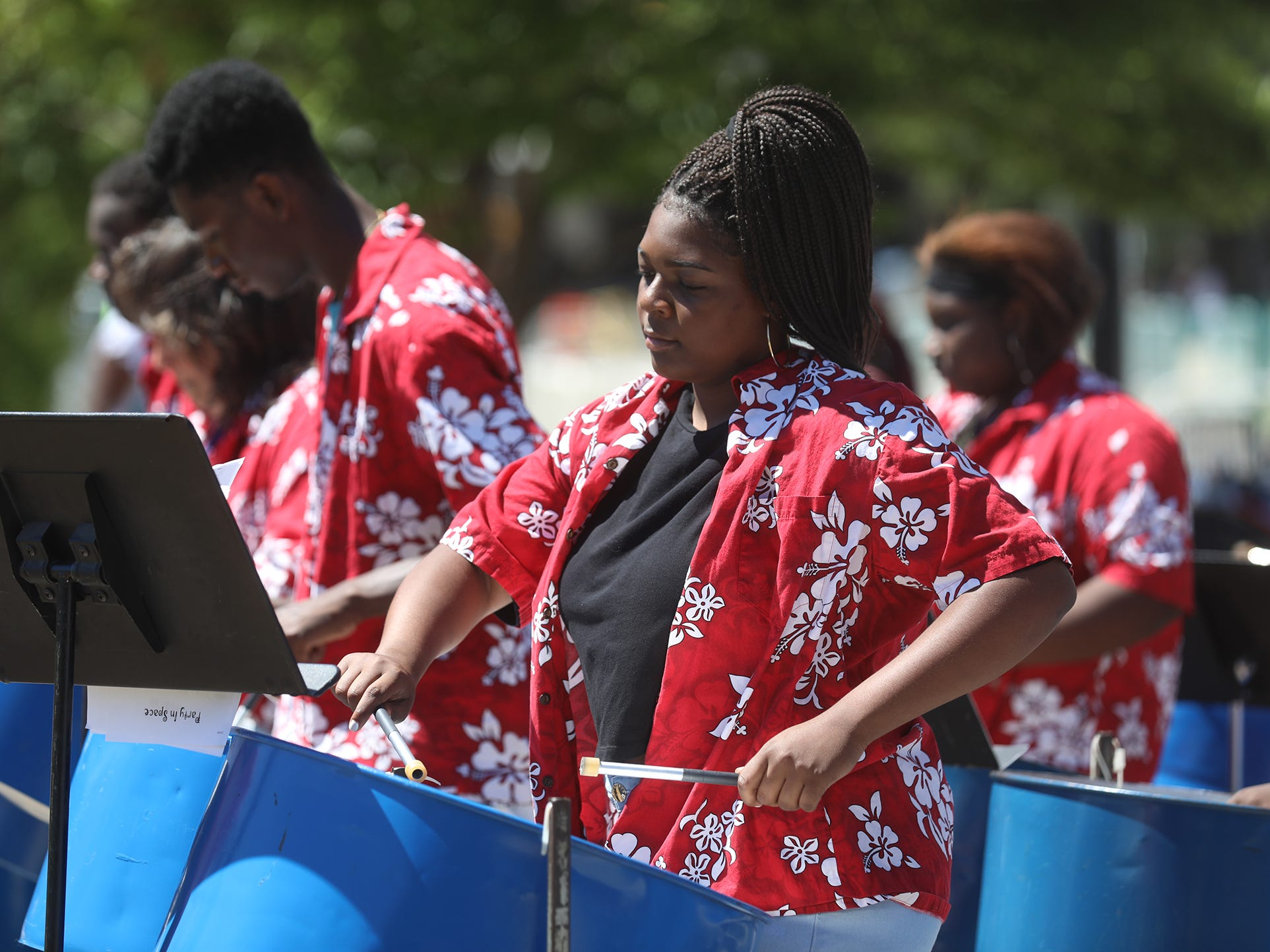 Skyasia Wright joins other students in the Rochester City School District Urban Steel band, plays songs at Carifest in Martin Luther King Jr. Memorial Park.