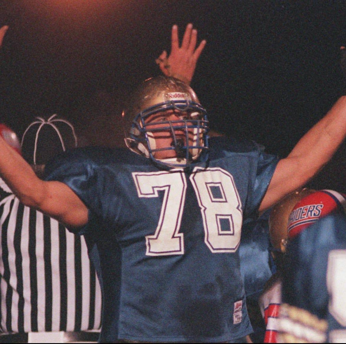 Webster's Matt Schifano celebrates a second-quarter touchdown against Fairport on Oct. 11, 1996.