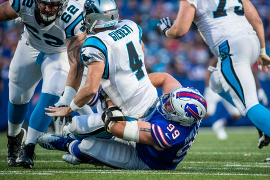 Harrison Phillips #99 of the Buffalo Bills sacks Garrett Gilbert #4 of the Carolina Panthers during the second quarter of a preseason game at New Era Field on August 9, 2018 in Orchard Park, New York.