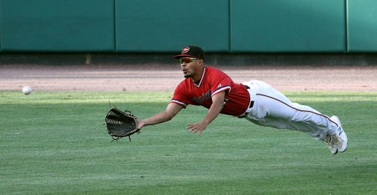 Red Wings left fielder Lamonte Wade makes a diving catch on a sinking line drive by Charlotte Elroy Jimenez.
