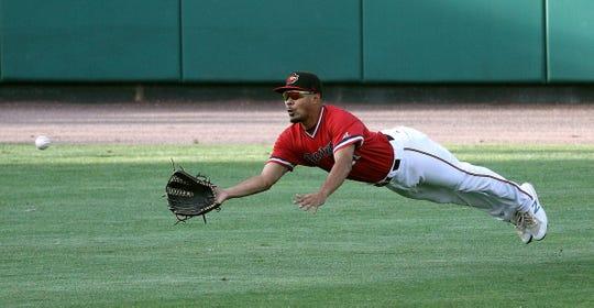 Red Wings left fielder Lamonte Wade makes a diving catch on a sinking line drive by Charlotte Elroy Jimenez.