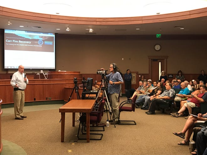 Shasta County Chief Executive Officer Larry Lees addresses the crowd at a meeting on rebuilding after the Carr Fire August 10, 2018 at Redding City Hall.