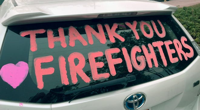 Signs and posters can be seen throughout Redding thanking firefighters, first responders and the National Guard for their help in fighting the Carr Fire.