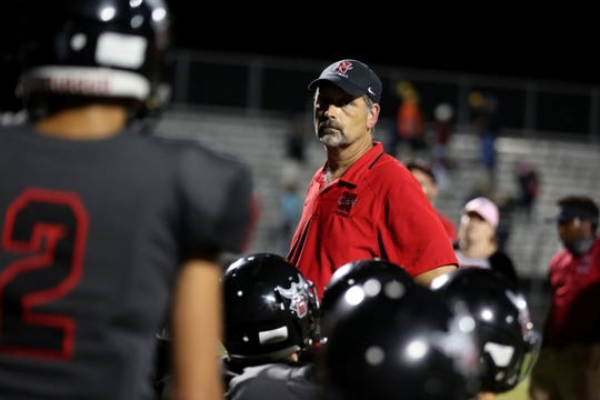 North Salem head coach Jeff Flood talks to his team following the Forest Grove vs. North Salem football game at North Salem High School on Friday, Sept. 8, 2017. Forest Grove won the game 13-6.