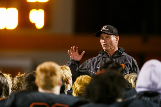 Sprague head coach Jay Minyard talks to the team following a 56-7 loss against Jesuit in a second round OSAA 6A state playoff game against Jesuit on Friday, Nov. 10, 2017, at Sprague High School.
