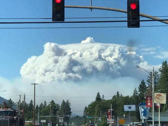 The Klondike Fire threw up a major smoke column visible from Cave Junction on Friday.