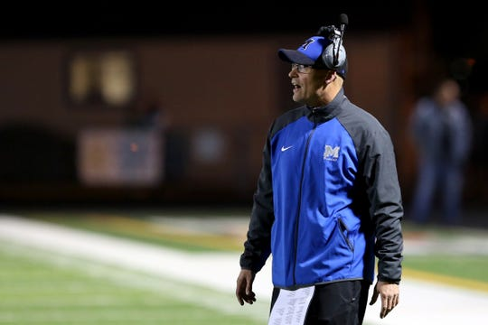 McNary head coach Jeff Auvinen calls out to his team in the Grants Pass vs. McNary football game in the first round of the OSAA class 6A playoffs at McNary High School in Keizer on Friday, Nov. 3, 2017.