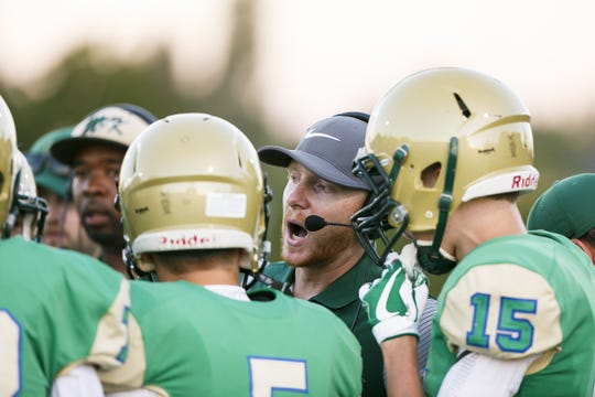 McKay football head coach Josh Riddell talks to players in the first quarter of a game against West Salem at McKay High School on Friday, Sept. 1, 2017, in Salem, Ore. This is McKay's first game on their newly installed turf field, which was completed over the summer.
