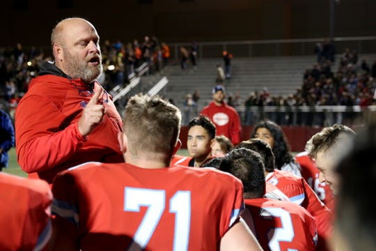 South Salem head coach Scott Scott DuFault talks to his team following the North Salem vs. South Salem football game at South Salem High School in Salem on Friday, Oct. 6, 2017. South South won the Mayor's Trophy 24-14.
