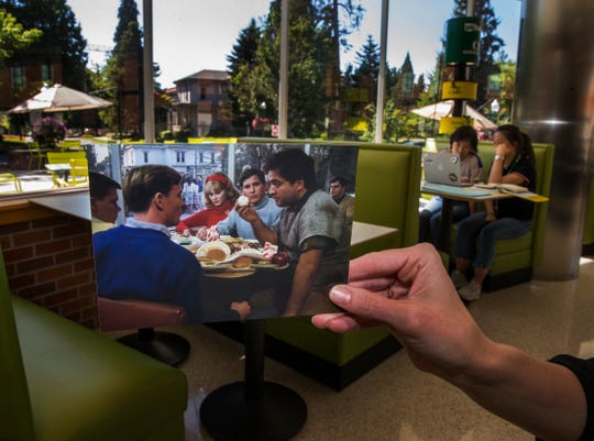 """In this July 27, 2018 photo, a photograph frm the movie """"Animal House"""" is held up in the ERB Memorial Union on the University of Oregon campus in Eugene."""