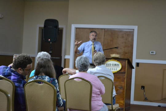 U.S. Rep. Andy Harris, R-Md.-1st District,  speaks to constituents during a town hall meeting in Fruitland on Friday, Aug. 10.