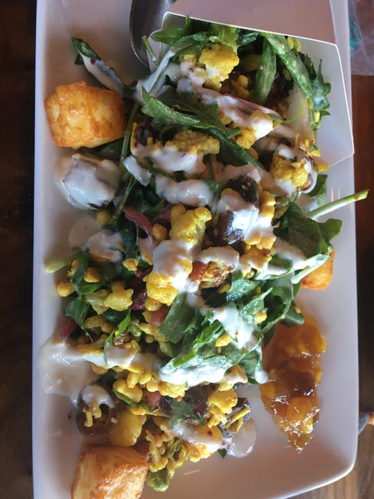 Linger is a Denver restaurant that showcases street food from around the world in sharable portions, like this Indian street food.