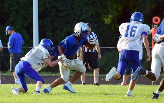 A Robert E. Lee ballcarrier is taken down by a Western Albemarle defender during their high school football scrimmage on Friday, Aug. 10, 2018, at Robert E. Lee High School in Staunton, Va.