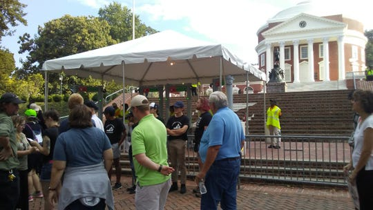 People gather before a rally at the University of Virginia's Rotunda on August 11, 2018, a year after white supremacists marched with torches on campus.