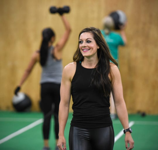 Dayna Deters smiles during a training session Saturday, Aug. 11, at Integration Fitness in St. Cloud.