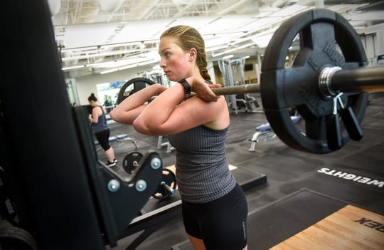 Paige Danielson lifts weights while working out Friday, Aug. 10, at the St. Cloud Area Family YMCA.