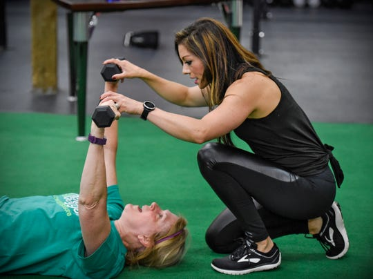 Trainer Dayna Deters gives some workout advice during a training session Saturday, Aug. 11, at Integration Fitness in St. Cloud.
