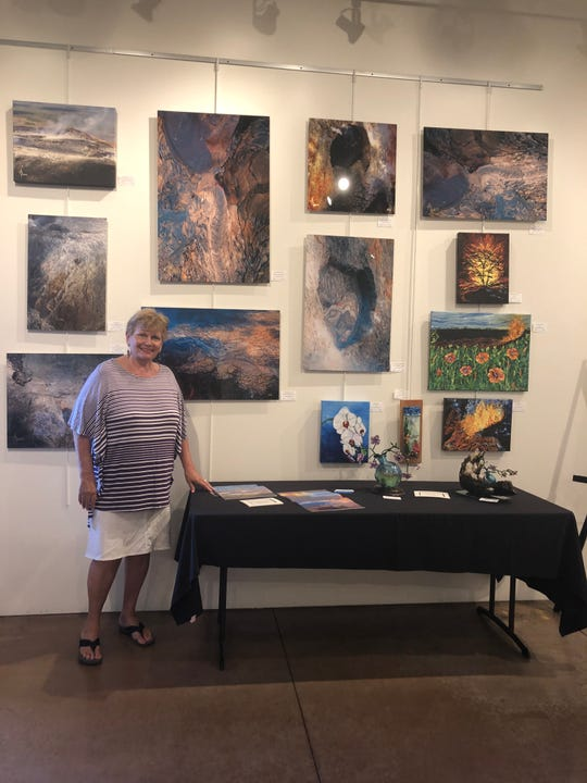 Artist AlixSandra Parness with her Artist of the Month showcase wall at the Mesquite Fine Arts Center.