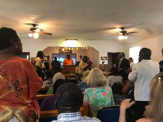 Friends and family fill a church on St. Marks Street to celebrate Cornelia Washington's 100th birthday.