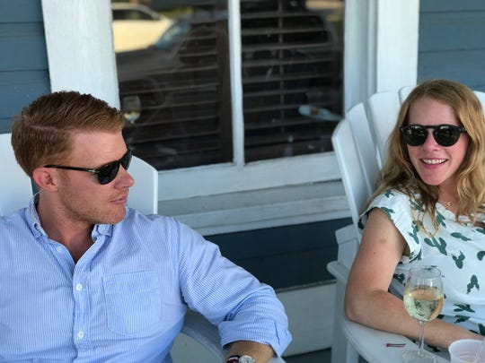 Steven Etchen, left, and his sister, Katharine E. Couillard, right, sitting at The Gibson Inn. Etchen is the new owner the landmark property in Apalachicola.
