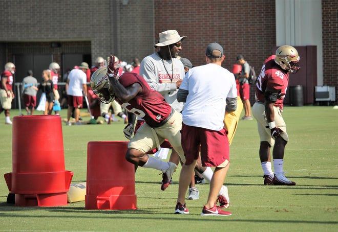 FSU linebacker Dontavious Jackson works through a pass rushing drill during Saturday's practice