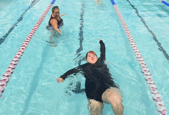 Volunteer swim coach Victoria Barnes of Fort Pierce (left) encourages swimmer Gracey Holdfield of Vero Beach Saturday, Aug. 11, 2018, as begins her backstroke during the Indian River Leisure Square swim team practice at Leisure Square in Vero Beach. The team practiced in preparation for the upcoming Area 10 Special Olympics.