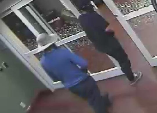 The robbery suspects forced their way into a West Side hotel lobby.