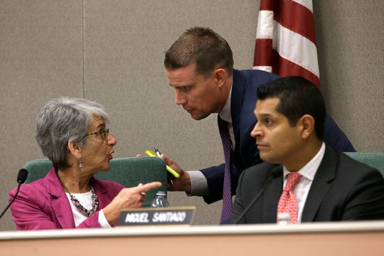 State Sen. Mark McGuire, D-Healdsburg, center, huddles with Sen. Hannah-Beth Jackson, D-Santa Barbara, and Assemblyman Miguel Santiago, D-Los Angeles, during a hearing looking into the failures of emergency warning systems in October's wildfires.