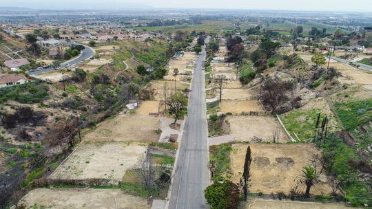 Empty lots where the Thomas Fire destroyed homes along Colina Vista in Ventura are shown in this May 23 photograph.