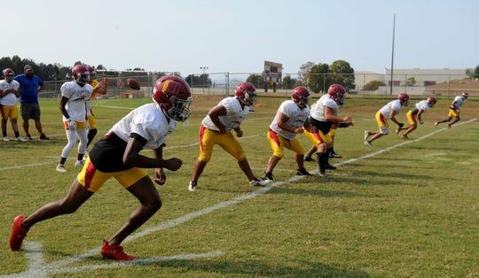 The Oxnard High offense runs through some plays at practice.