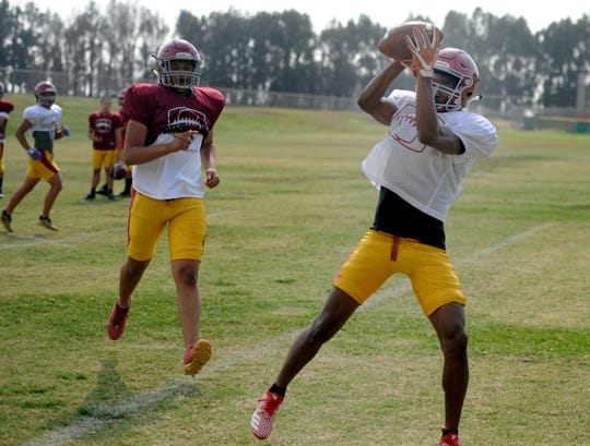 Oxnard High receiver JR Waters makes a catch during practice. Waters is one of the top returning players for Oxnard and figures to be one of the best in the revamped Pacific View League.