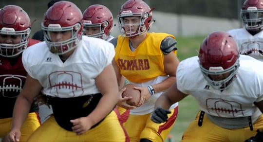 Quarterback Vincent Walea drops back to pass during a recent Oxnard High practice.