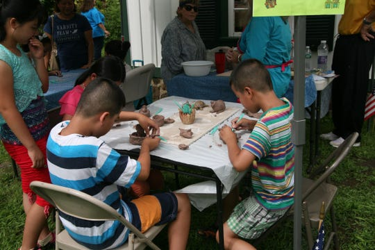 Children enjoy a craft activity during an open house at the Vineland Historical and Antiquarian Society.
