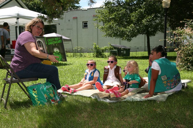 Children enjoy stories with Samanthy Tai, a librarian from Vineland Public Library, during an open house at the Vineland Historical and Antiquarian Society.