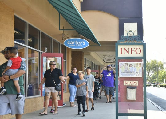 Thousands of people went to the Tulare Outlets to do their back to school shopping on Saturday, August 11.