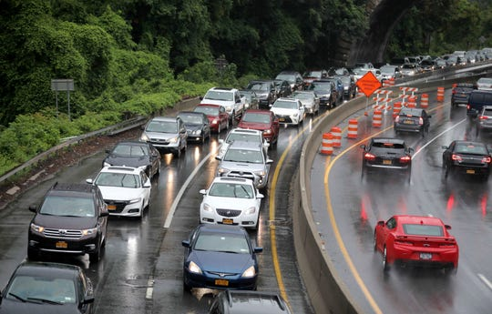 Traffic on the southbound Hutchinson River Parkway in Pelham, left, Aug, 11, 2018.