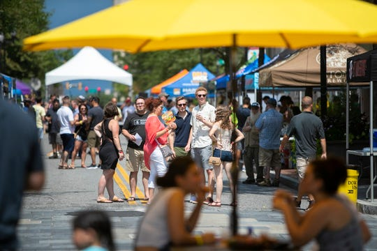 People gather on Market Street in Wilmington for the 2nd Annual Downtown Brewfest.