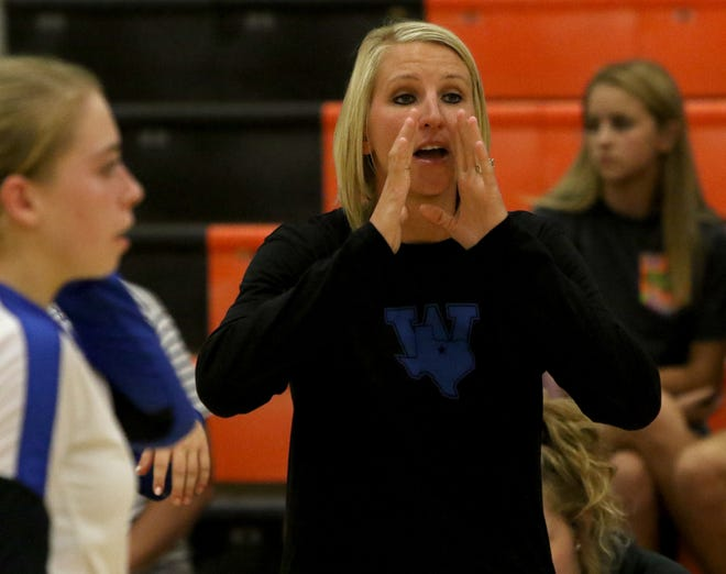 Windthorst head coach Allison Bussey talks to her team during their match against Boyd Saturday, Aug. 11, 2018, at the Cool in Boomtown volleyball tournament in Burkburnett. The Lady Jackets defeated the Trojanettes 25-20, 25-16 to leave with the championship.