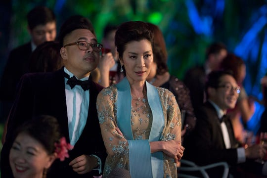 "Michelle Yeoh (right, pictured with Nico Santos) made sure the film's matriarch didn't become a caricature. ""I don't believe a mother is a villain. The mother is nurturing, protective, she sees the big picture,"" Yeoh says."