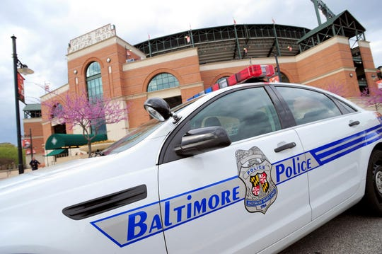 File photo: A Baltimore police car sits outside Oriole Park at Camden Yards.