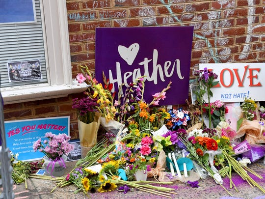 Flowers, signs and chalk messages mark the place where Heather Heyer died last year, on the day before the anniversary of her death at the Downtown Mall in Charlottesville, Va., on Saturday, August 11, 2018.